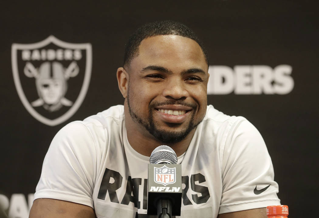 Oakland Raiders running back Doug Martin speaks to reporters at the team's NFL football training facility in Alameda, Calif., Tuesday, May 29, 2018. (AP Photo/Jeff Chiu)
