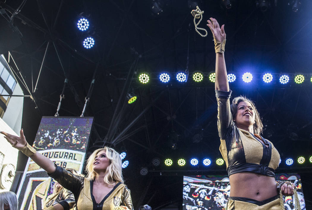 """The Golden Knights cheerleaders throw beads into the crowd during """"Stick Salute to Vegas and Our Fans"""" on Wednesday, June 13, 2018, at the Fremont Street Experience, in Las Vegas. Be ..."""