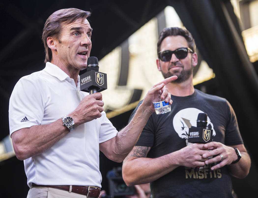 """Golden Knights general manger George McPhee, left, thanks the fans for their support during """"Stick Salute to Vegas and Our Fans"""" on Wednesday, June 13, 2018, at the Fremont Street Ex ..."""