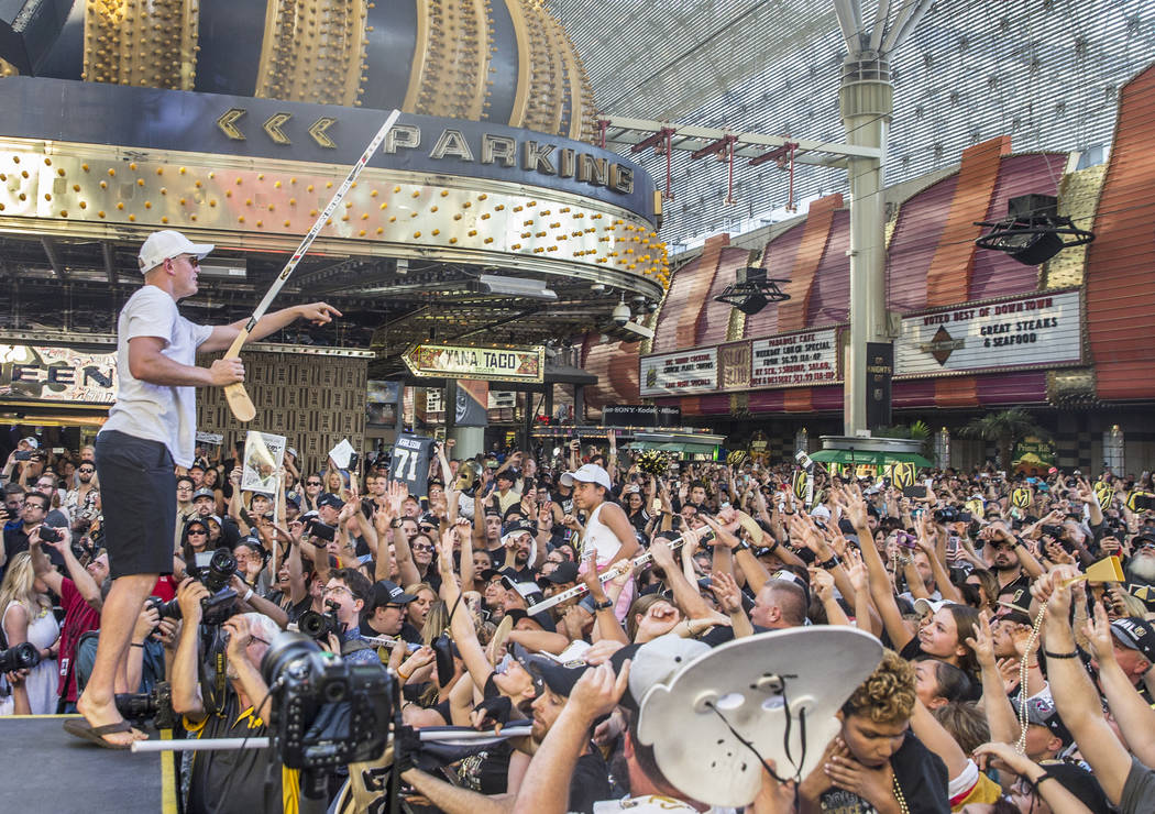 "Golden Knights defenseman Nate Schmidt, left, looks for a fan to give his stick to during ""Stick Salute to Vegas and Our Fans"" on Wednesday, June 13, 2018, at the Fremont Street Expe ..."