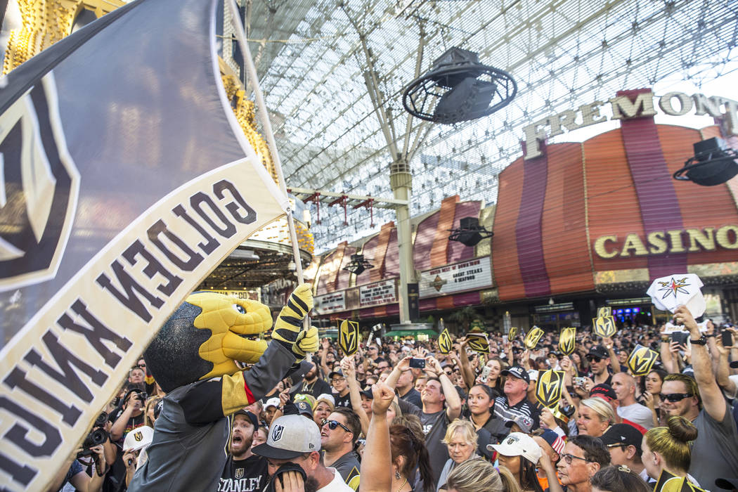 "Golden Knights mascot Chance, left, fires up the crowd during ""Stick Salute to Vegas and Our Fans"" on Wednesday, June 13, 2018, at the Fremont Street Experience, in Las Vegas. Benjam ..."