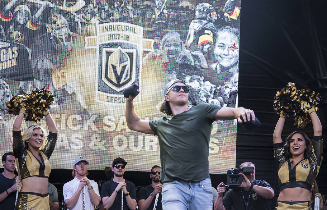 """Golden Knights center William Karlsson throws a shirt into the crowd during """"Stick Salute to Vegas and Our Fans"""" on Wednesday, June 13, 2018, at the Fremont Street Experience, in Las ..."""