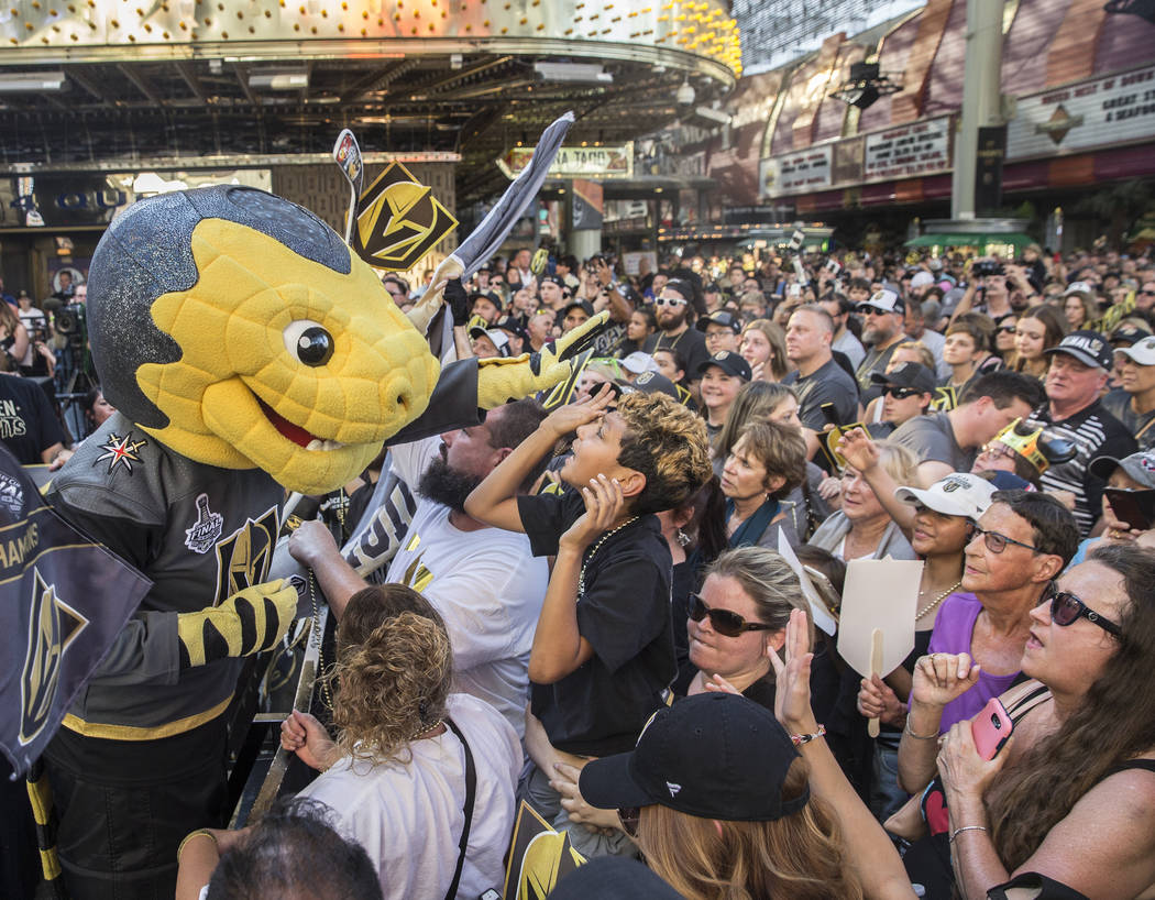 """Golden Knights mascot Chance, left, entertains the crowd during """"Stick Salute to Vegas and Our Fans"""" on Wednesday, June 13, 2018, at the Fremont Street Experience, in Las Vegas. Benjamin ..."""