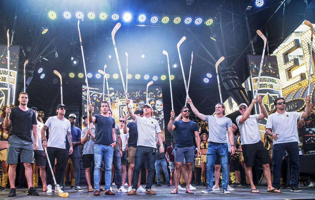 """Golden Knights players raise their sticks to the crowd during """"Stick Salute to Vegas and Our Fans"""" on Wednesday, June 13, 2018, at the Fremont Street Experience, in Las Vegas. Benjam ..."""