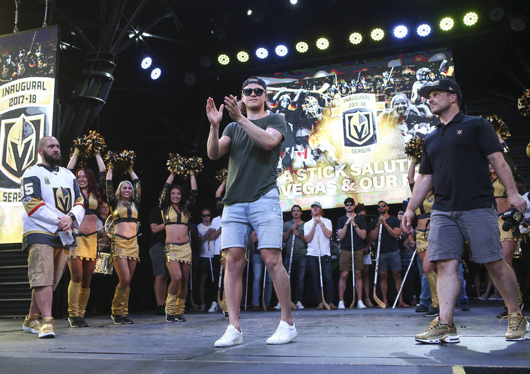 """Golden Knights center William Karlsson celebrates during the """"Stick Salute to Vegas and Our Fans"""" held by the Golden Knights at the 3rd Street Stage at the Fremont Street Experience in d ..."""