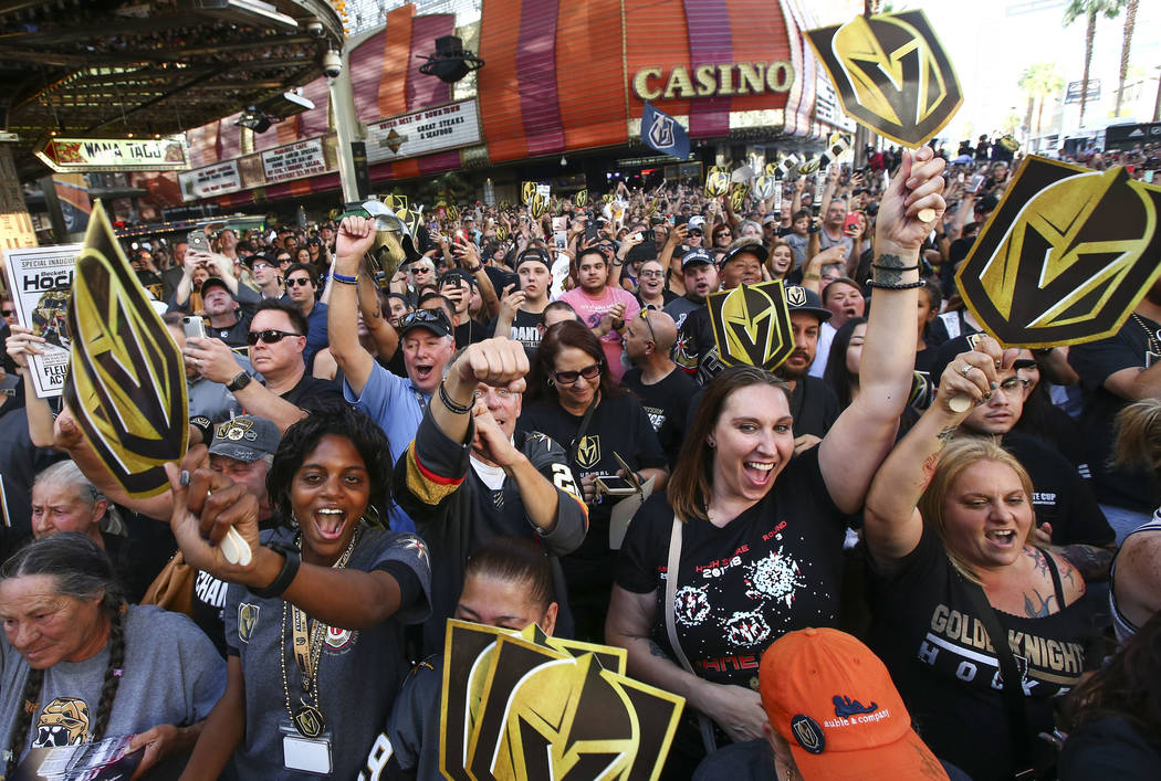 "Golden Knights fans celebrate during the ""Stick Salute to Vegas and Our Fans"" held by the Golden Knights at the 3rd Street Stage at the Fremont Street Experience in downtown Las Vegas on ..."