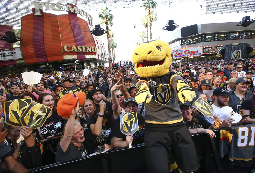 """Golden Knights mascot Chance poses with the crowd during the """"Stick Salute to Vegas and Our Fans"""" held by the Golden Knights at the 3rd Street Stage at the Fremont Street Experience in d ..."""
