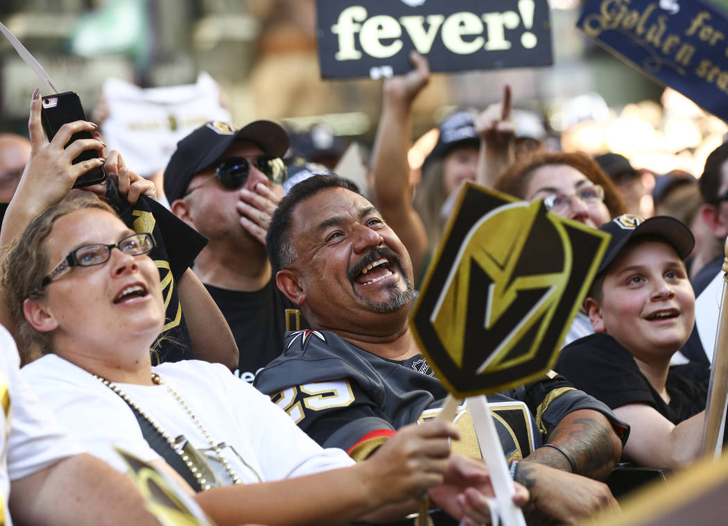 """Golden Knights fans celebrate during the """"Stick Salute to Vegas and Our Fans"""" held by the Golden Knights at the 3rd Street Stage at the Fremont Street Experience in downtown Las Vegas on ..."""