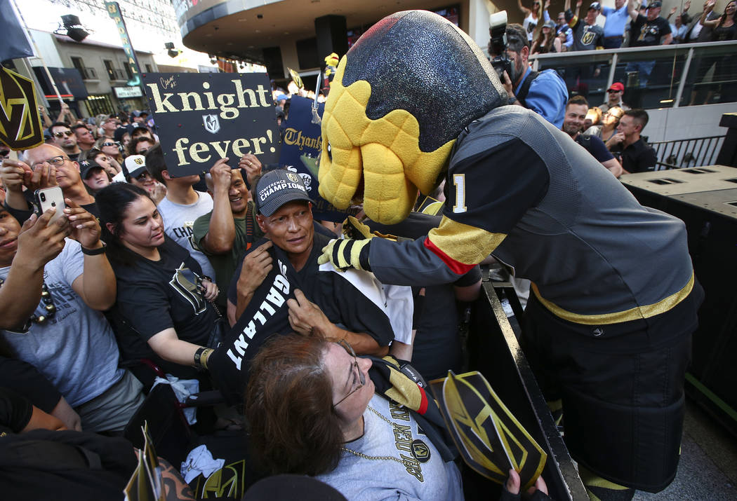 "Golden Knights mascot Chance autographs items for fans during the ""Stick Salute to Vegas and Our Fans"" held by the Golden Knights at the 3rd Street Stage at the Fremont Street Experience ..."