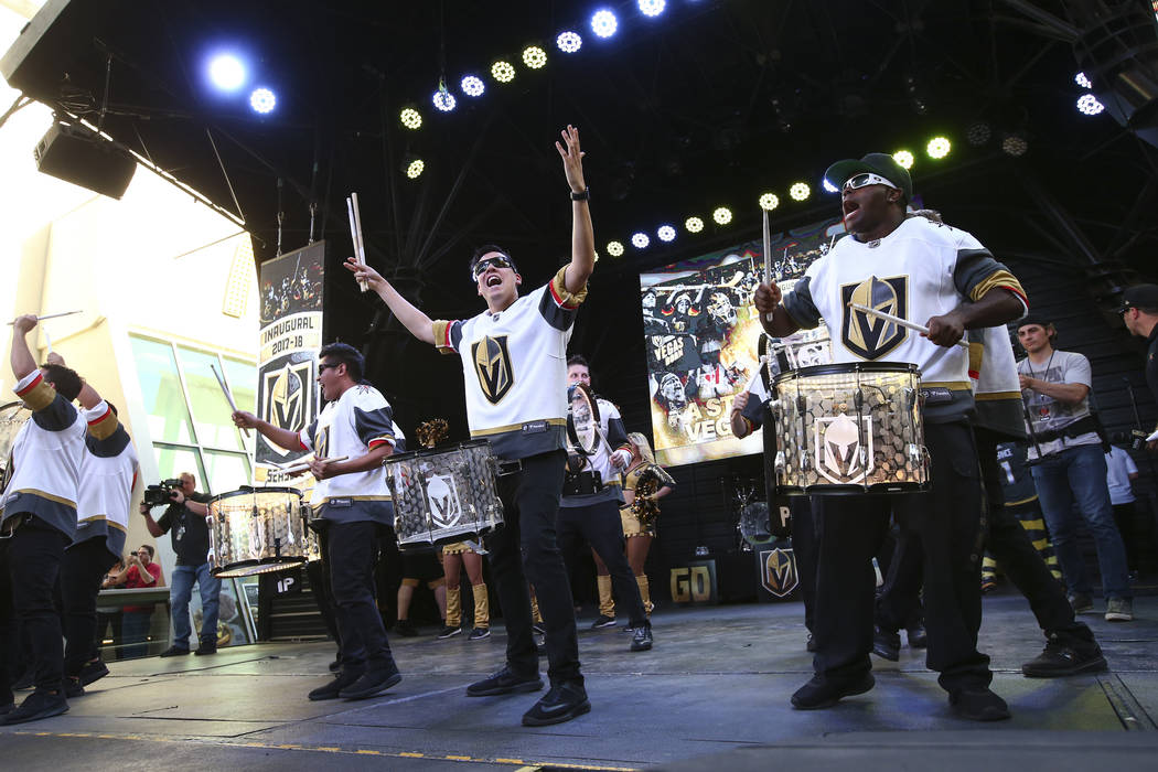 "Members of the Knight Line perform during the ""Stick Salute to Vegas and Our Fans"" held by the Golden Knights at the 3rd Street Stage at the Fremont Street Experience in downtown Las Veg ..."