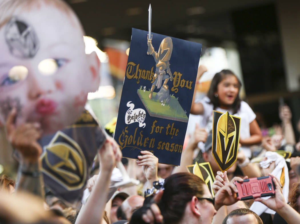 "Golden Knights fans cheer during the ""Stick Salute to Vegas and Our Fans"" held by the Golden Knights at the 3rd Street Stage at the Fremont Street Experience in downtown Las Vegas on Wed ..."