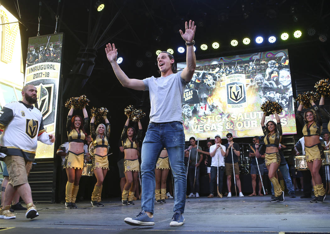 """Golden Knights left wing Erik Haula celebrates during the """"Stick Salute to Vegas and Our Fans"""" held by the Golden Knights at the 3rd Street Stage at the Fremont Street Experience in down ..."""