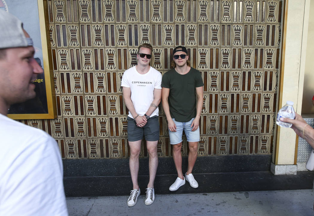 """Golden Knights goaltender Oscar Dansk, left, and center William Karlsson, both Swedish players, pose for a photo following the """"Stick Salute to Vegas and Our Fans"""" held by the Golden Kni ..."""