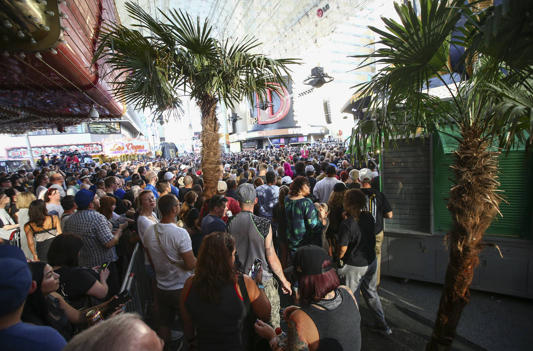 """Golden Knights fans crowd around during the """"Stick Salute to Vegas and Our Fans"""" held by the Golden Knights at the 3rd Street Stage at the Fremont Street Experience in downtown Las Vegas ..."""