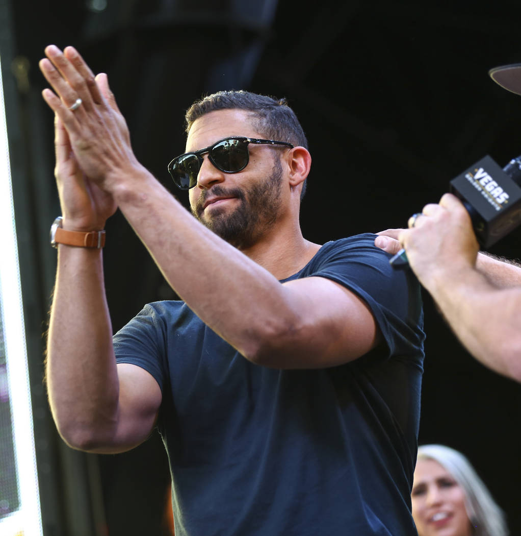 """Golden Knights left wing Pierre-Edouard Bellemare celebrates during the """"Stick Salute to Vegas and Our Fans"""" held by the Golden Knights at the 3rd Street Stage at the Fremont Street Expe ..."""