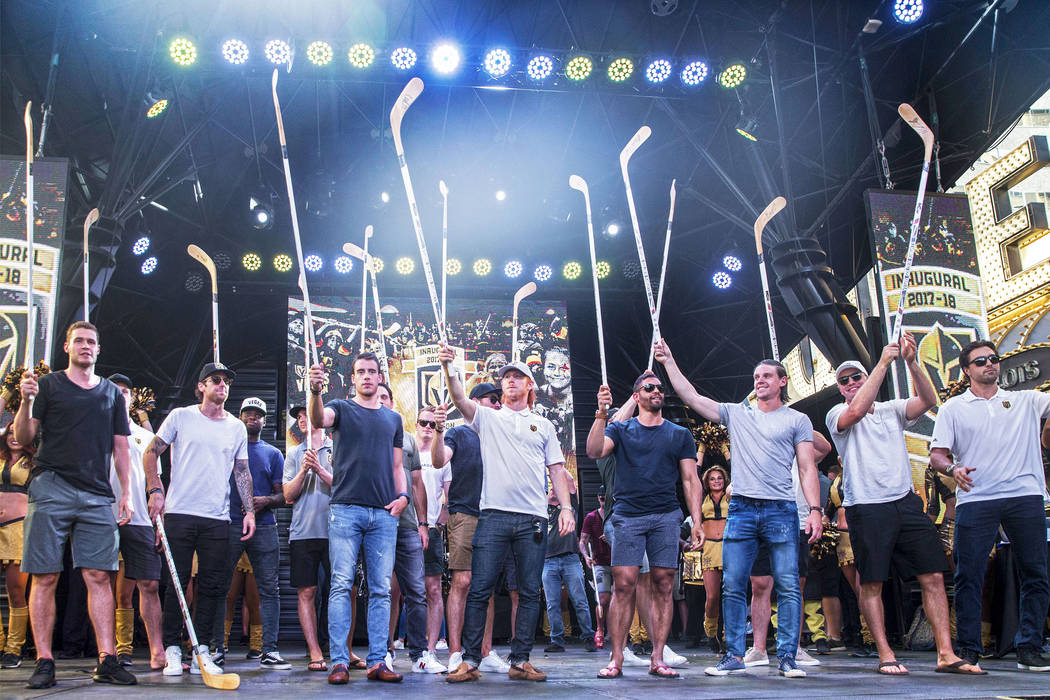 "Golden Knights players raise their sticks to the crowd during ""Stick Salute to Vegas and Our Fans"" on Wednesday, June 13, 2018, at the Fremont Street Experience, in Las Vegas. Benjam ..."