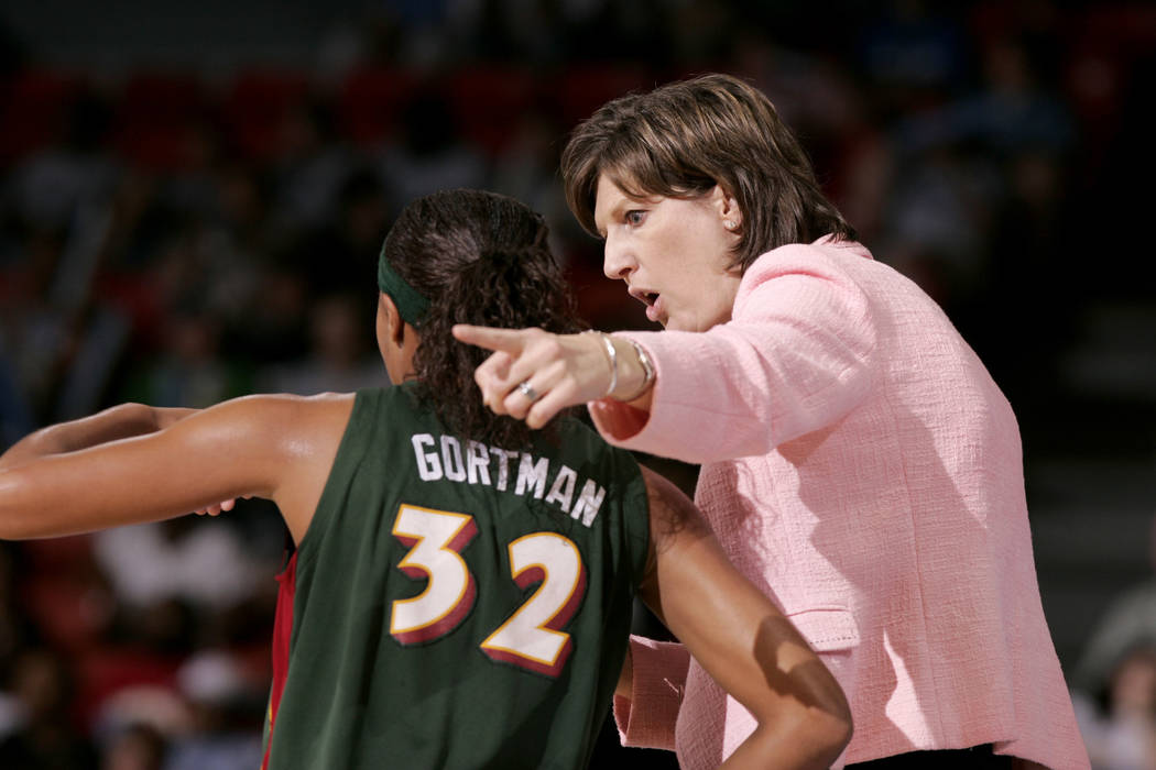 Seattle Storm coach Anne Donovan, right, talks to Shaunzinski Gortman during the fourth quarter of the team's WNBA basketball game against the Chicago Sky in Chicago in 2006. (AP Photo/Jeff Rober ...