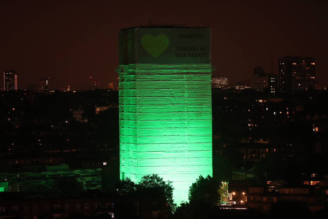 Grenfell Tower in west London is illuminated in green to mark a year since the moment the devastating fire took hold, claiming 72 lives, Thursday June 14, 2018. Thursday marks 12 months since a sm ...