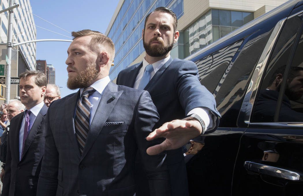 Mixed martial arts fighter Conor McGregor leaves a Brooklyn Supreme court, Thursday, June 14, 2018, in New York. (AP Photo/Mary Altaffer)