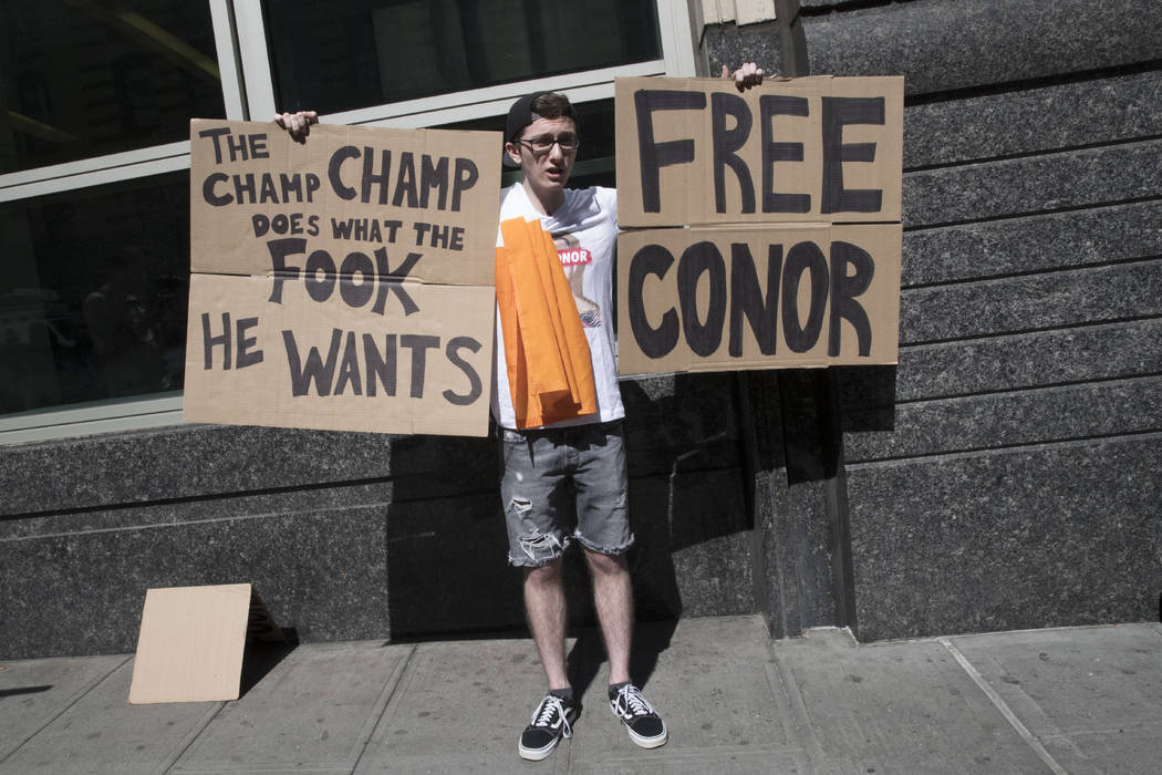 A fan of Former UFC champion Conor McGregor shows his support outside Brooklyn Supreme court, Thursday, June 14, 2018, in New York. (AP Photo/Mary Altaffer)