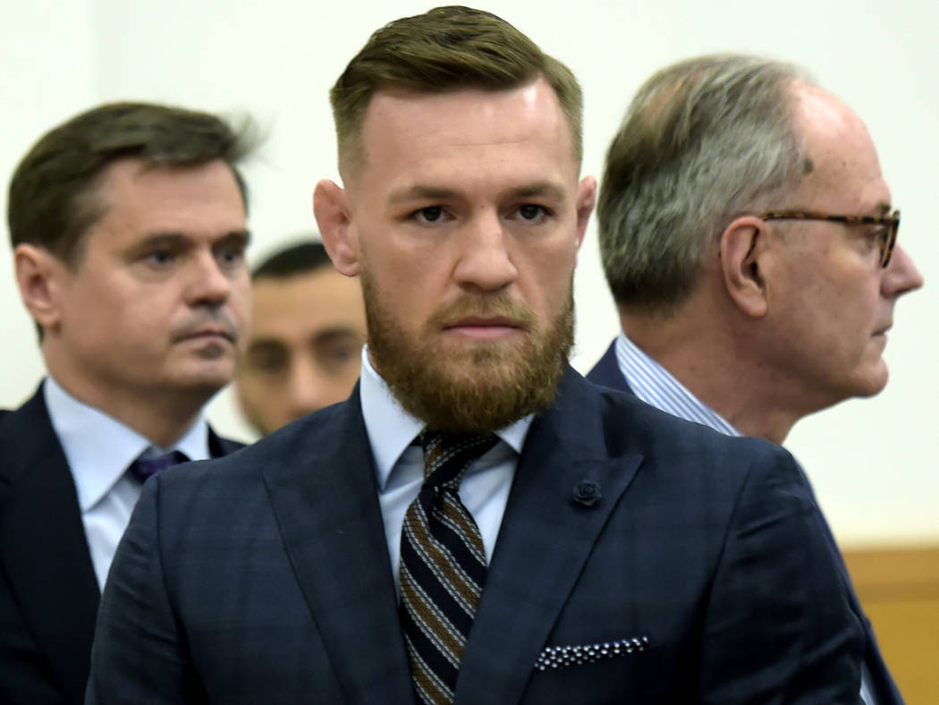 Mixed martial arts fighter Conor McGregor, center, arrives at Brooklyn Supreme Court, Thursday, June 14, 2018, in New York. (Rashid Umar Abbasi /New York Post via AP, Pool)