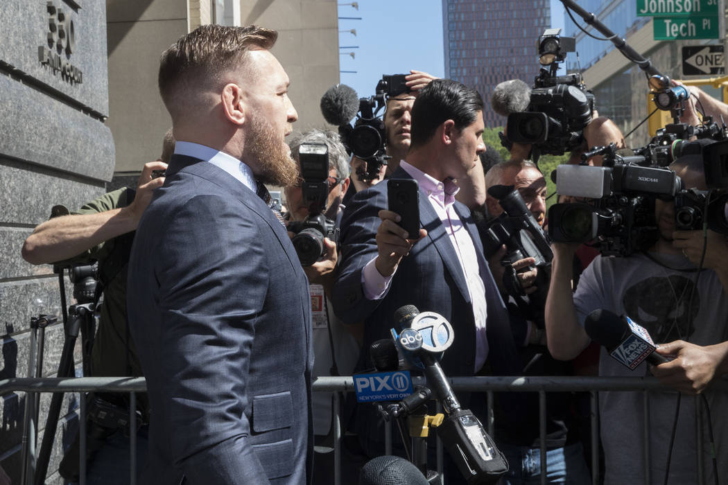 Mixed martial arts figher Conor McGregor is escorted by court officers as he leaves a Brooklyn Supreme court, Thursday, June 14, 2018, in New York. (AP Photo/Mary Altaffer)