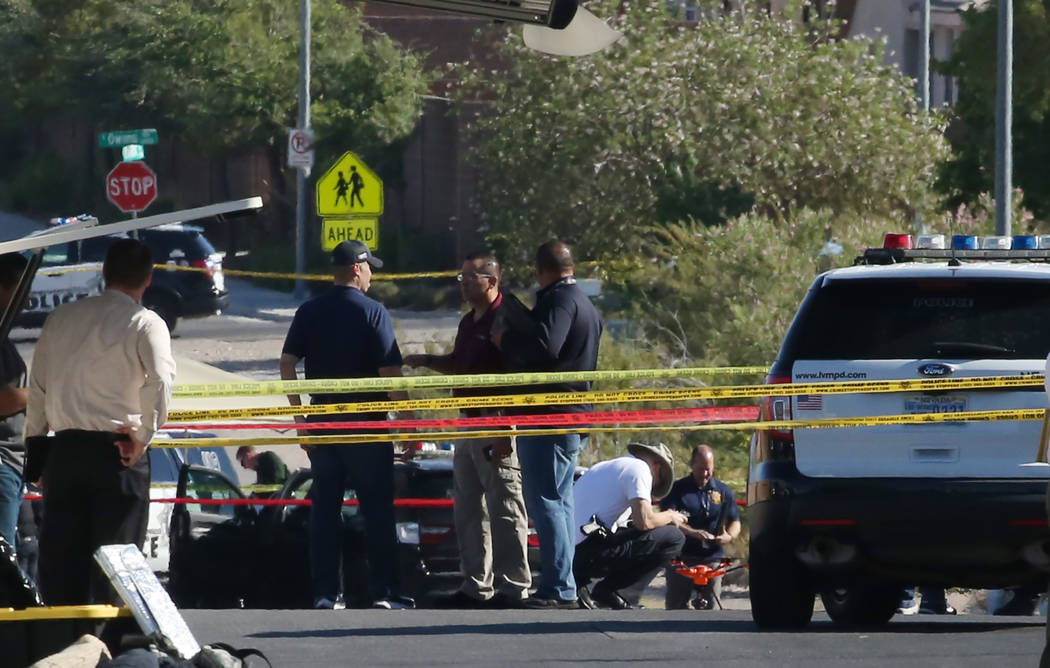 Las Vegas police are investigating an officer-involved shooting at Radwick Drive and Owens Avenue in the northeast valley near Mike O'Callaghan Middle School on Thursday, June 14, 2018. A robbery ...
