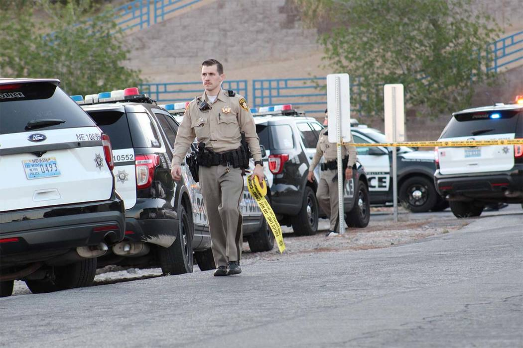 Las Vegas police are investigating an officer-involved shooting at Radwick Drive and Owens Avenue in the northeast valley. A robbery suspect was shot and killed. (Max Michor/Las Vegas Review-Journal)