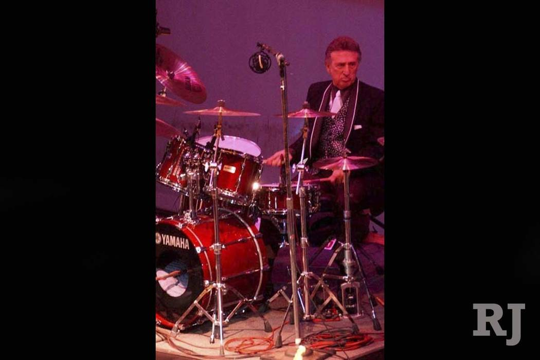 In this Oct. 16, 2004 file photo, longtime Elvis Presley drummer D.J. Fontana performs at the 50th anniversary celebration concert of Elvis Presley's first performance at the Louisiana Hayride in ...