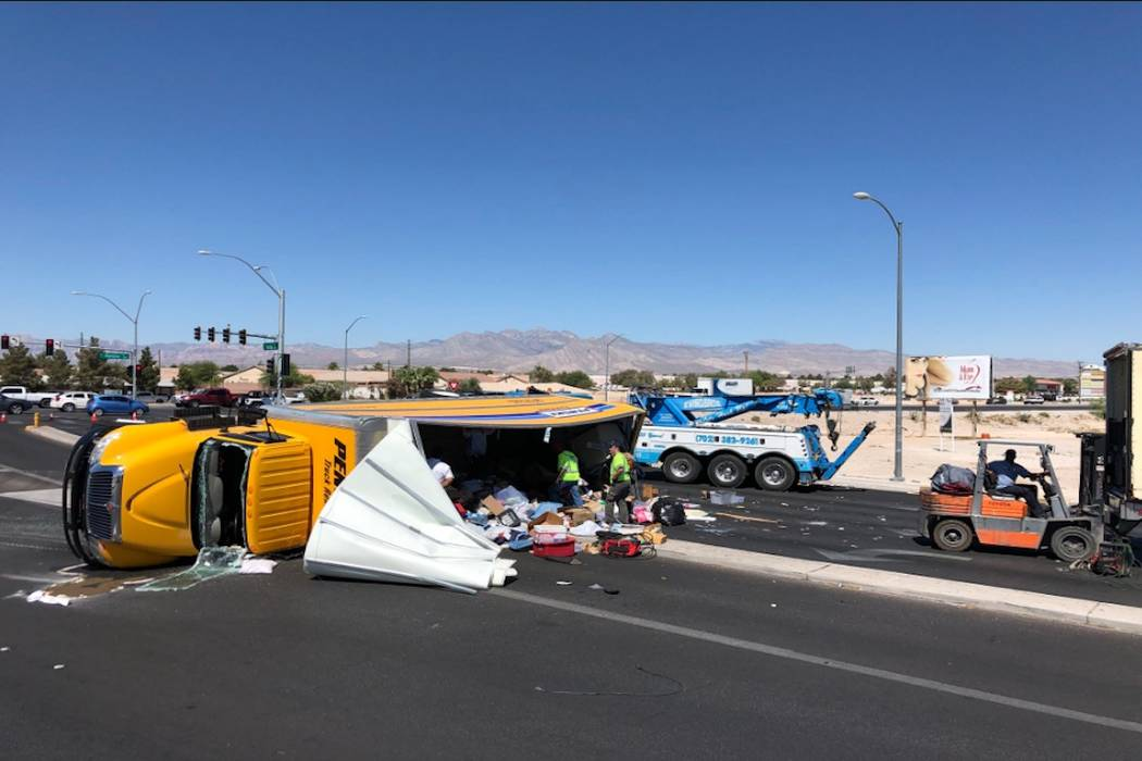 Decatur Boulevard is closed near North Las Vegas Airport, between Cheyenne Avenue and Rancho Drive, after a truck and vehicle crashed, Thursday, June 12, 2018. (K.M. Cannon/Las Vegas Review-Journal)