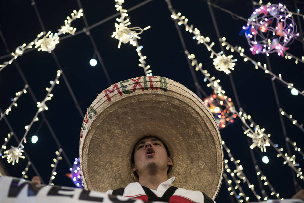 A Mexico soccer fan wearing a sombrero chants as fans gather on Nikolskaya Street ahead of the 2018 soccer World Cup in Moscow, Russia, Wednesday, June 13, 2018. Fans from participating countries ...