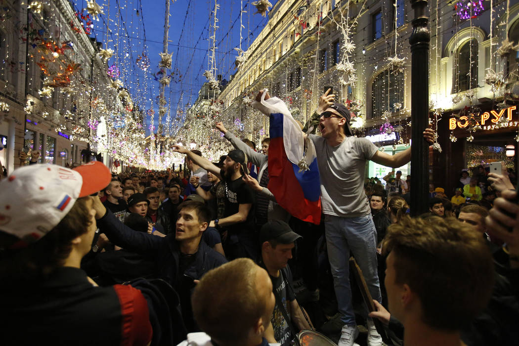 Russia fans celebrate in Nikolskaya street after their team defeated Saudi Arabia 5-0 in the opening match of the 2018 soccer World Cup, in Moscow, Russia, Thursday, June 14, 2018.(AP Photo/Rebecc ...