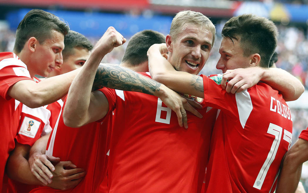 Russia's Yuri Gazinsky celebrates with teammates after scoring his side's first goal during the group A match between Russia and Saudi Arabia which opens the 2018 soccer World Cup at the Luzhniki ...