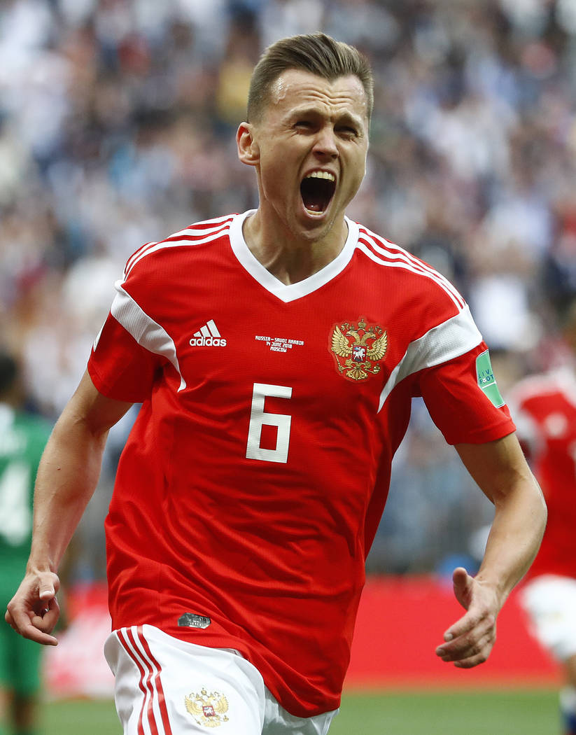 Russia's Denis Cheryshev celebrates after scoring his side's second goal during the group A match between Russia and Saudi Arabia which opens the 2018 soccer World Cup at the Luzhniki stadium in M ...