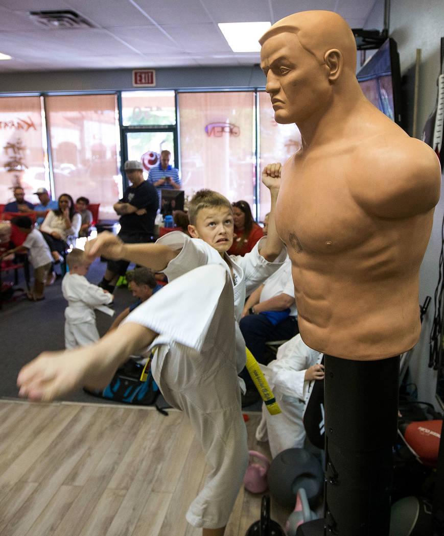 Yellow belt Robert Jalbert, 10, high kicks the body opponent bag during karate practice at Shinkyokushinkai Las Vegas on Monday, June 11, 2018. Richard Brian Las Vegas Review-Journal @vegasphotograph