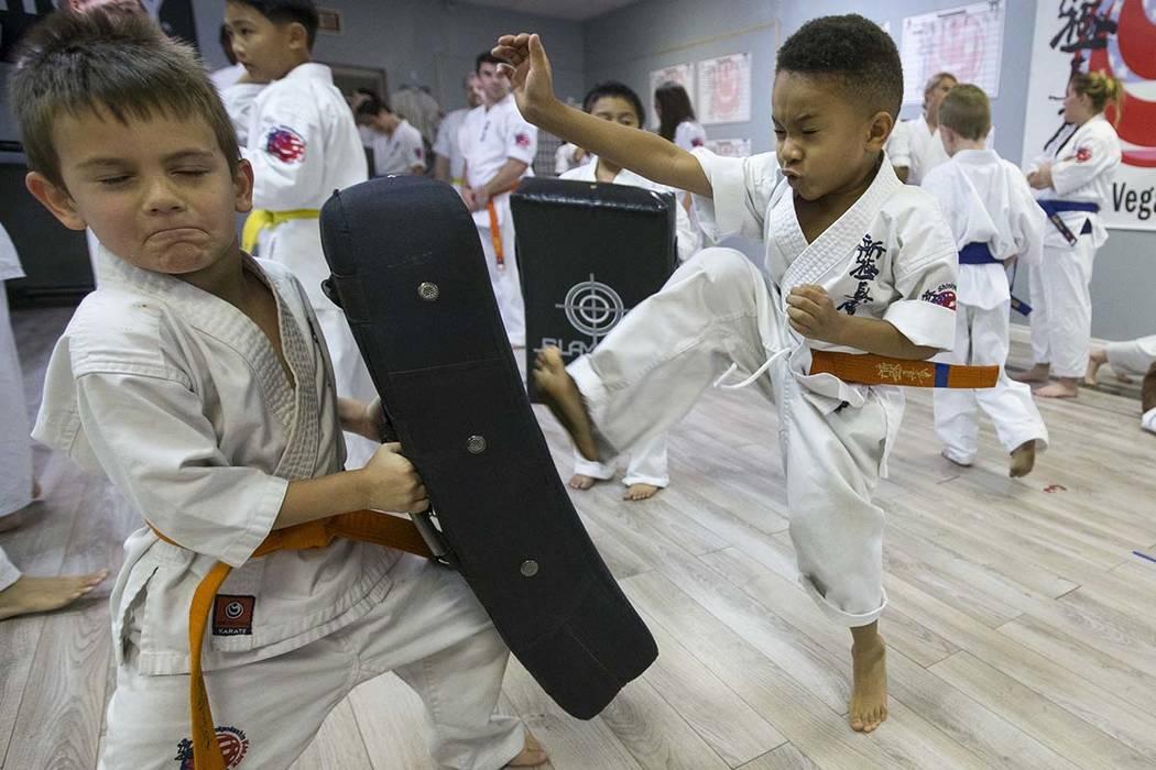Five-year-old orange belts Kalub Liuzza, left, and James Luck take part in a karate practice at Shinkyokushinkai Las Vegas on Monday, June 11, 2018. Richard Brian Las Vegas Review-Journal @vegasph ...