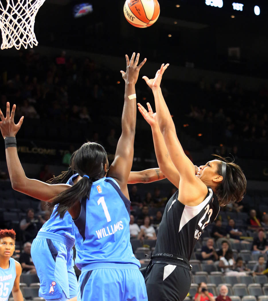 Las Vegas Aces center A'ja Wilson (22) goes for a rebound against Atlanta Dreams' Elizabeth Williams (1) in the first half of a WNBA basketball game at the Mandalay Bay Event Center in Las Vegas o ...