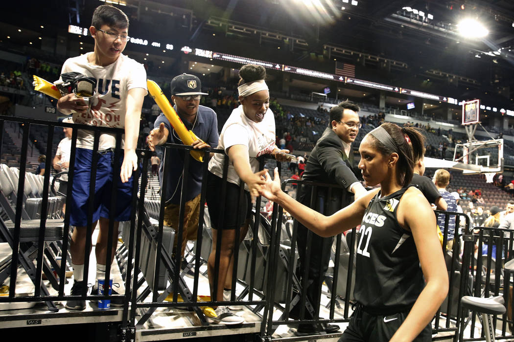 Las Vegas Aces center A'ja Wilson (22) shakes hands with fans after a WNBA basketball game against the Atlanta Dreams at the Mandalay Bay Event Center in Las Vegas on Friday, June 8, 2018. Bizuaye ...