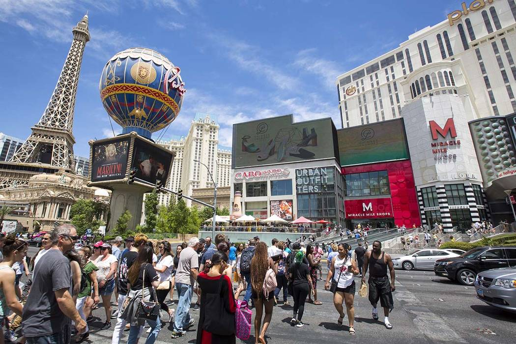 People cross the street outside the Paris Las Vegas and Planet Hollywood Resort on the Strip, Thursday, May 31, 2018. Richard Brian Las Vegas Review-Journal @vegasphotograph