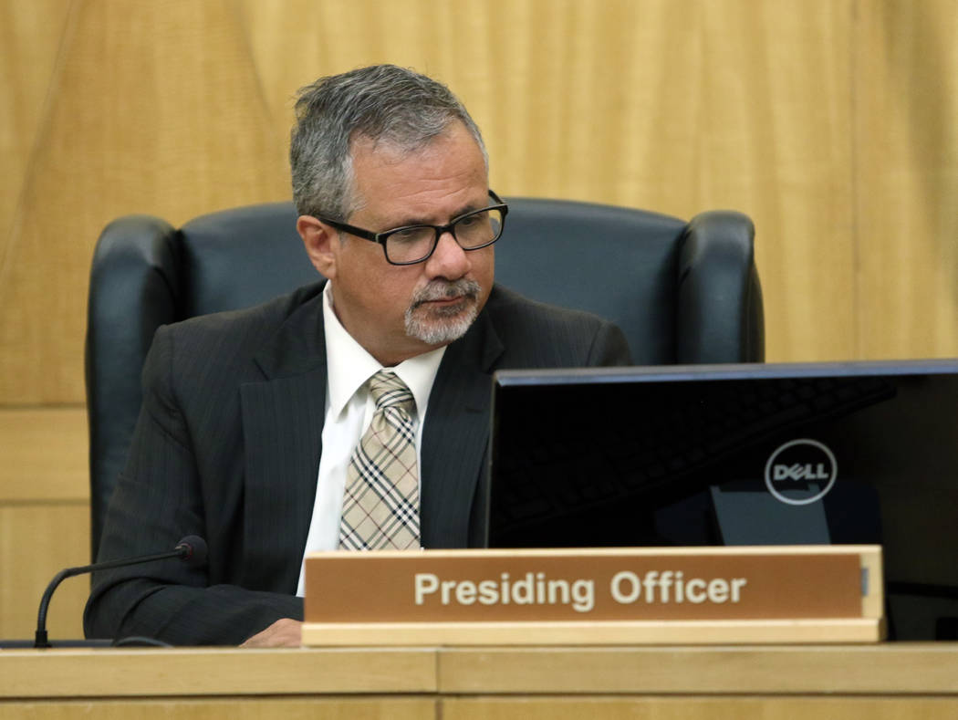 Ozzie Fumo looks over data during a police fact finding review at Clark County Government Center Wednesday, June 10, 2015, in Las Vegas. (Ronda Churchill/Las Vegas Review-Journal)