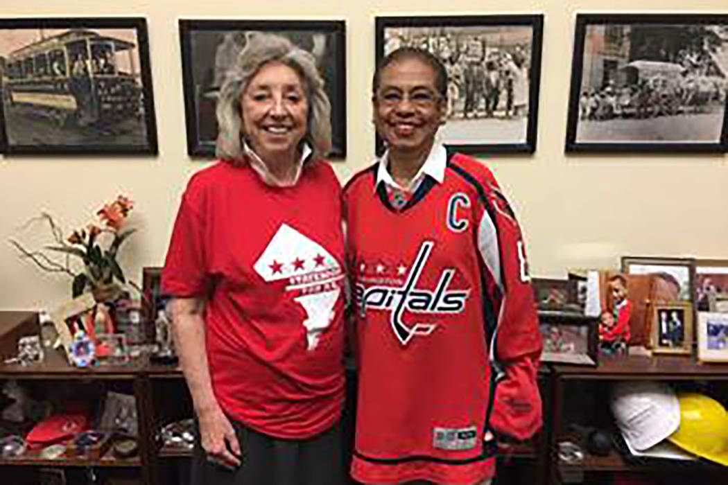 Rep. Dina Titus, D-Nev., left, donned a T-shirt emblazoned with a D.C. statehood slogan to honor her loss in a bet with Eleanor Holmes Norton, right, the district's non-voting delegate to the Ho ...