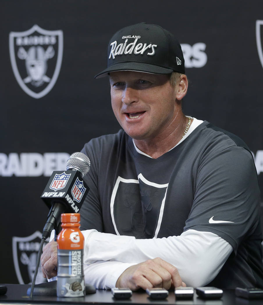 Oakland Raiders coach Jon Gruden responds to a question at the NFL football team's minicamp Tuesday, June 12, 2018, in Alameda, Calif. Gruden coached the Raiders from 1998 through 2001 before bein ...