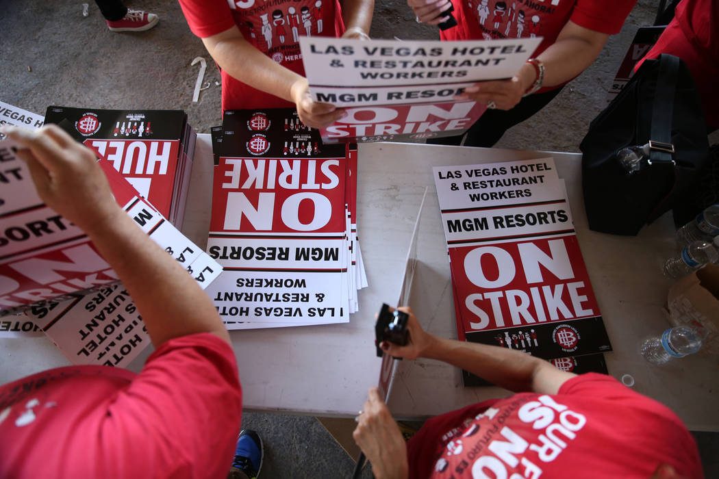 """Culinary Union organizers make strike picket signs at the newly opened """"Strike HQ"""" at the intersection of Wyoming Avenue and Fairfield Avenue in Las Vegas, Friday, June 1, 2018. Erik ..."""