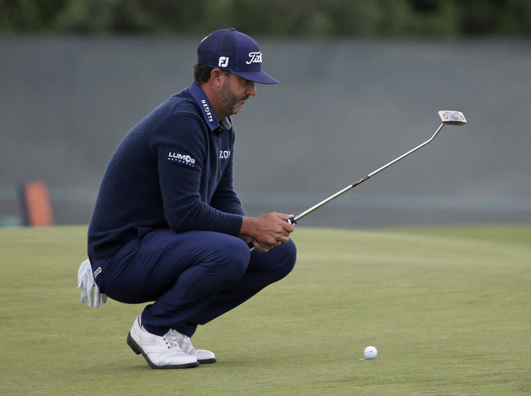Scott Piercy checks his lie on the fifth green during the second round of the U.S. Open Golf Championship, Friday, June 15, 2018, in Southampton, N.Y. (AP Photo/Seth Wenig)