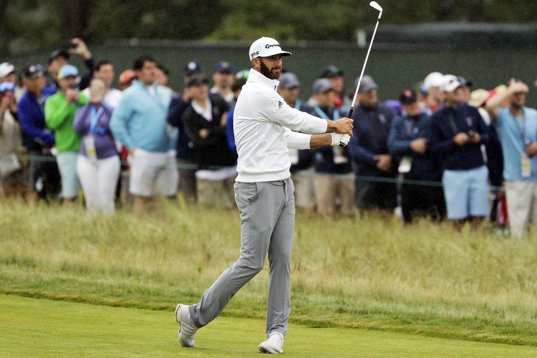 Dustin Johnson hits an approach shot on the second hole during the second round of the U.S. Open Golf Championship, Friday, June 15, 2018, in Southampton, N.Y. (AP Photo/Frank Franklin II)