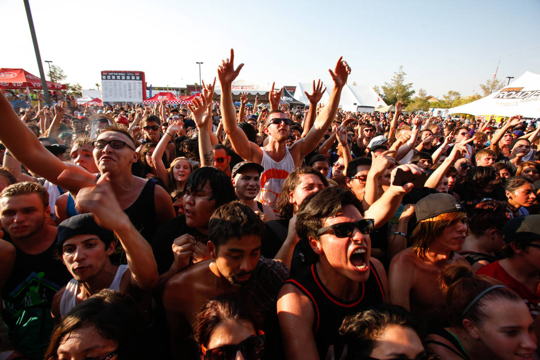 Fans watch Memphis May Fire perform at the Kia Soul stage during the Warped Tour at the parking lot of the Silverton Casino in Las Vegas on Friday, June 28, 2013. (Chase Stevens/Las Vegas Review-J ...