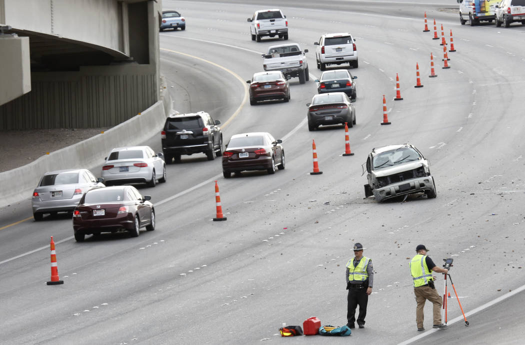 Nevada Highway Patrol investigates an accident on southbound U.S. 95 in Las Vegas in March. (Bizuayehu Tesfaye/Las Vegas Review-Journal)
