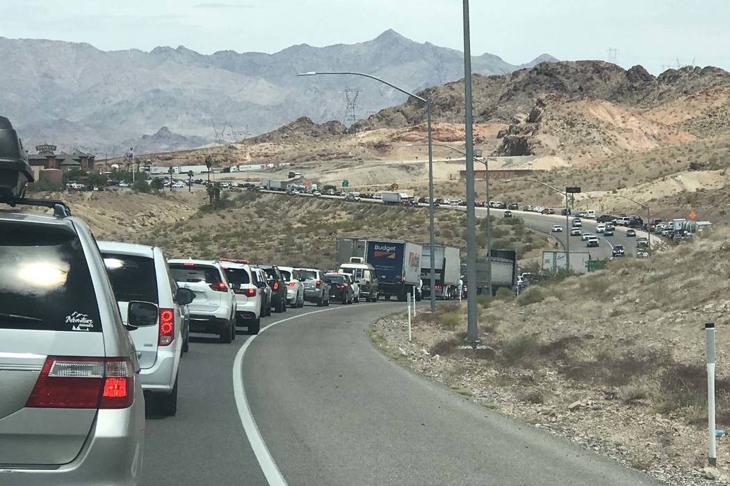 Southbound traffic on U.S. Highway 93 south of Las Vegas, headed toward Hoover Dam, was backed up after police closed the Mike O'Callaghan-Pat Tillman Memorial Bridge during an incident with a man ...