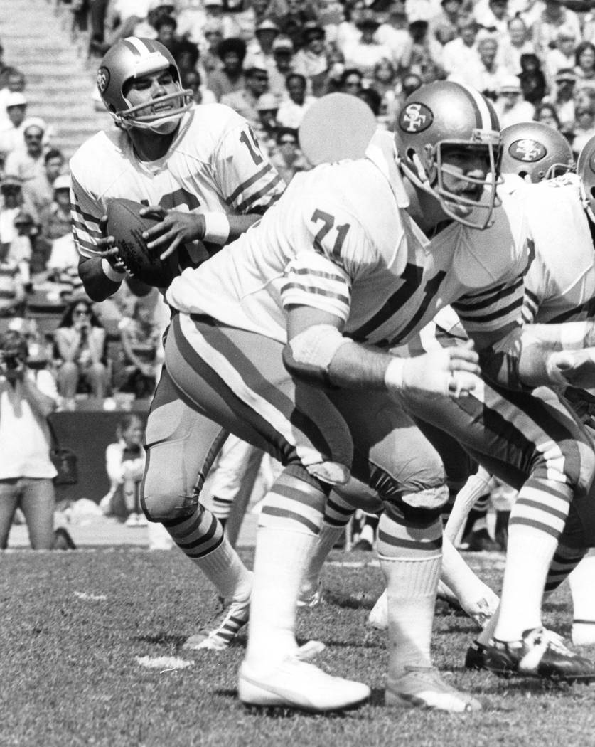 This Oct. 2, 1977, photo provided by the NFL shows San Francisco 49ers tackle Keith Fahnhorst (71) blocking for quarterback Jim Plunkett (16) as he drops back to pass against the Los Angeles Rams, ...