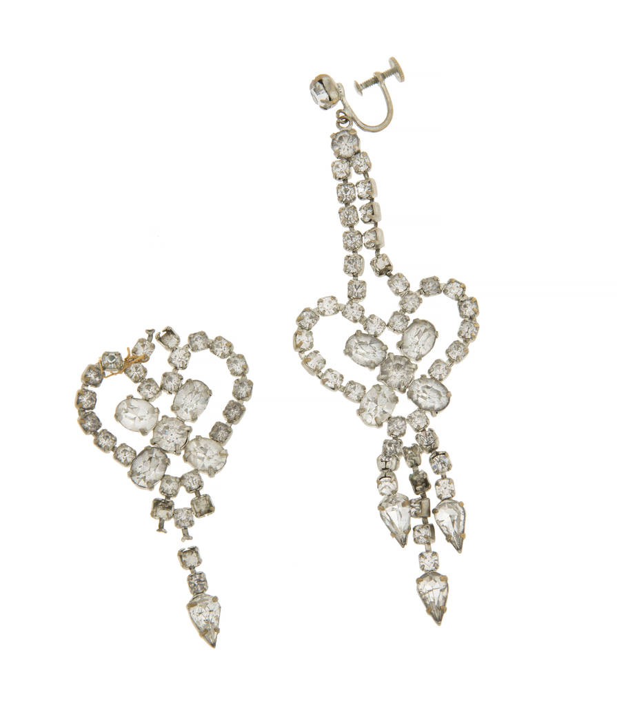 A rhinestone dangling heart-shaped earring with three drops, screwback post. Together with two fragment pieces of the matching pair. Accompanied by the original Christie's lot card. (Julien's Auc ...